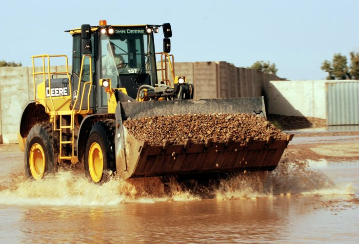 John Deere feels impact of energy slowdown in 3Q as construction equipment sales fall 13%.
